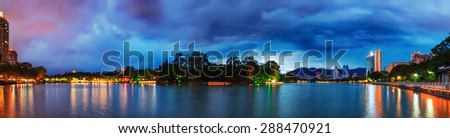 Dramatic sky before storm over a famous chinese water park in Fuzhou,  a city of southeast China. Panorama from 8 shots. - stock photo