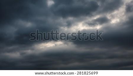 Dramatic sky. Dark storm clouds before rain - stock photo