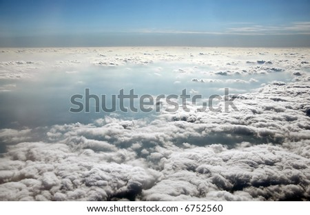 dramatic sky from above: sunlit from one side, dark from beneath - stock photo