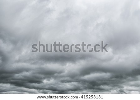 Dramatic sky -Grey storm clouds - stock photo