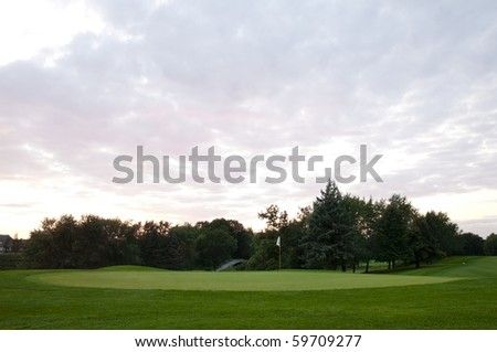Dramatic sky on the 9th hole at the local golf club - stock photo