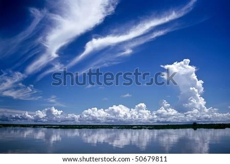 Dramatic sky over a lake in Cambodia - stock photo
