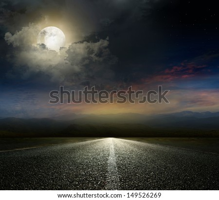 Dramatic sky over an asphalt road - stock photo