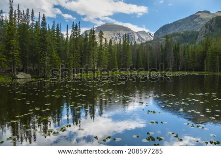 Dramatic sky over beautiful Bierstadt Lake with stunning view of Hallett Peak and Flattop Mountain -  Colorado - stock photo