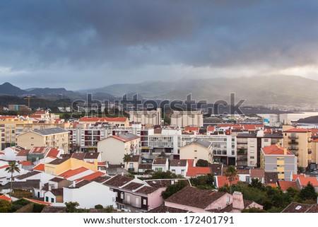 Dramatic sky over city Ponta Delgada, Azores, San Miguel (Sao Miguel) island. Early morning. - stock photo