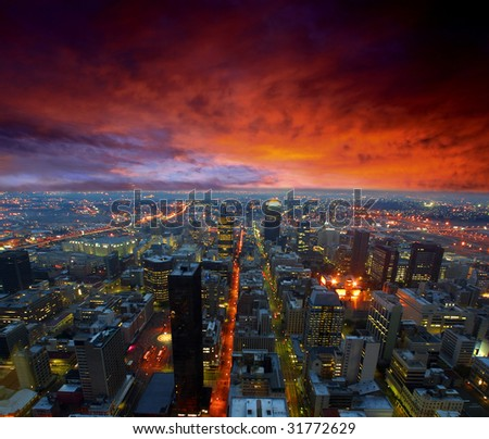 Dramatic sky over city streets - stock photo