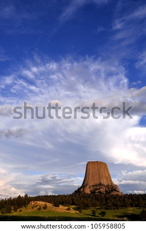 Dramatic sky over Devils Tower National Monument in Wyoming, USA, at sunset. - stock photo