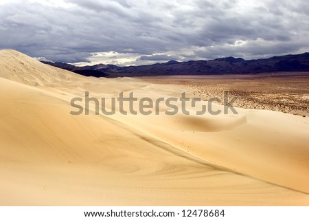 Dramatic sky over Eureka sand dunes in Death Valley national park, California - stock photo