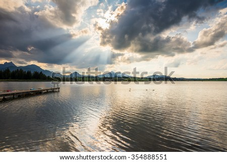 Dramatic sky over Lake Hopfensee in Bavaria (Germany) - stock photo