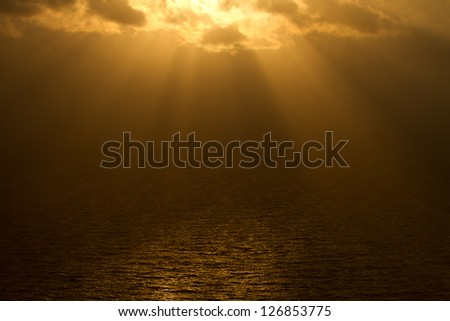 dramatic sky over ocean - stock photo