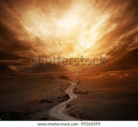 Dramatic sky over road in a valley. - stock photo