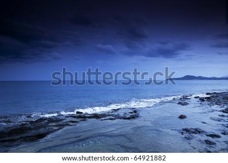 Dramatic sky over sea - stock photo