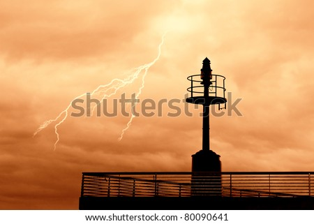 dramatic sky over the port in the night - stock photo