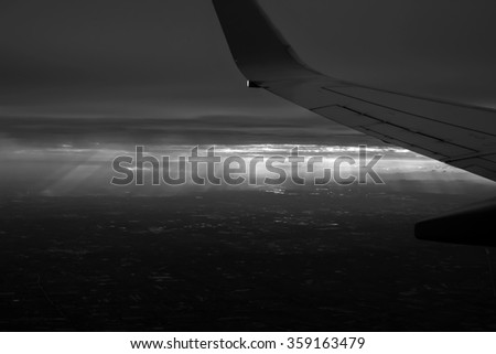 Dramatic sky seen from the airplane; black and white tone