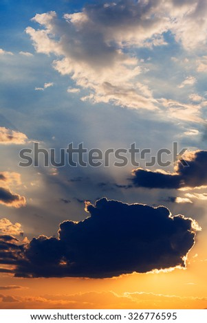 Dramatic sky with clouds at sunset summer evening ray