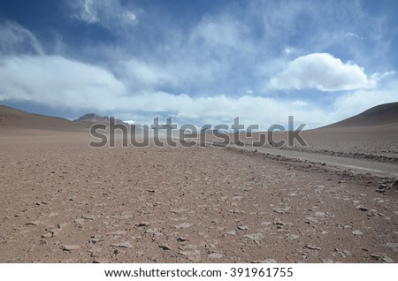 Dramatic sky with different kind of clouds at Uyuni desert in Bolivia. - stock photo
