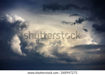 Dramatic sky with stormy clouds before rain and thunderstorm  - stock photo