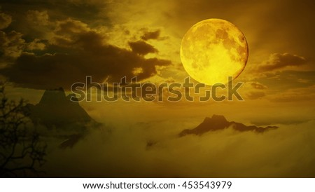 Dramatic sky with tree, full moon and clouds over mountain, Warm orange tone. - stock photo