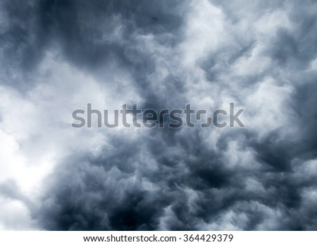 Dramatic storm clouds on a summer day. - stock photo