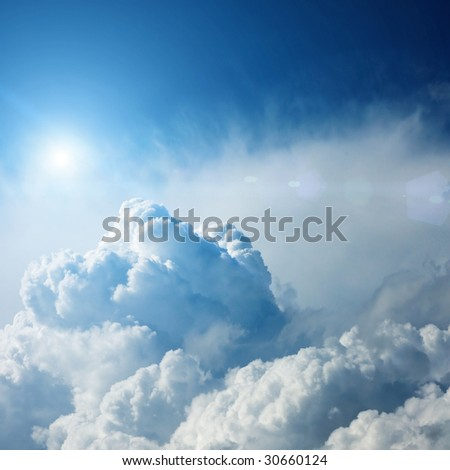 dramatic storm clouds with sun - stock photo