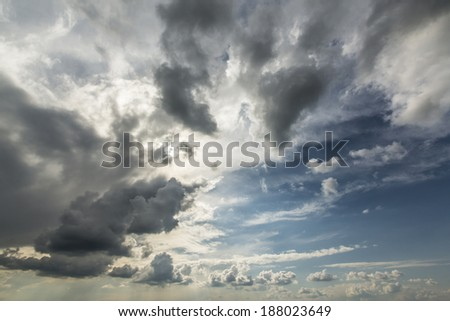 Dramatic storm cloudscape, with strange cloud shapes and rain - stock photo