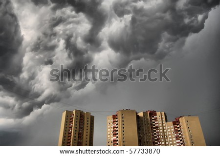 Dramatic stormy clouds over row of tipical residential houses.Kiev,Ukraine - stock photo