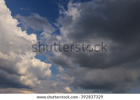 Dramatic  stormy dark and light clouds in the blue sky before rain. - stock photo