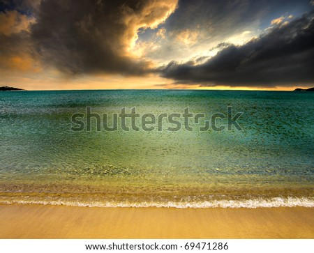 dramatic, stormy sky approaching the beach - stock photo