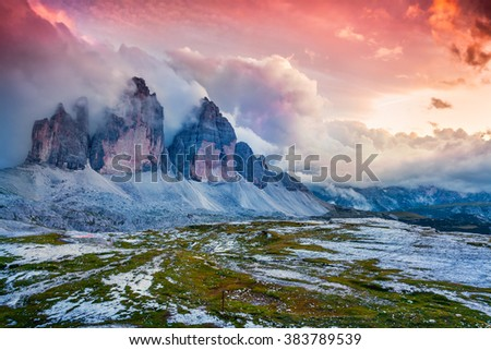 Dramatic summer scene in National Park Tre Cime di Lavaredo. Foggy sunset in Dolomite Alps, South Tyrol. Location Auronzo, Italy, Europe. - stock photo