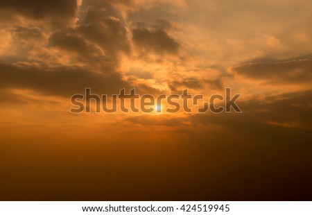 Dramatic summer silhouette vivid sunset view at mountain refletion on lake water waves. Summer sea and lake background.
