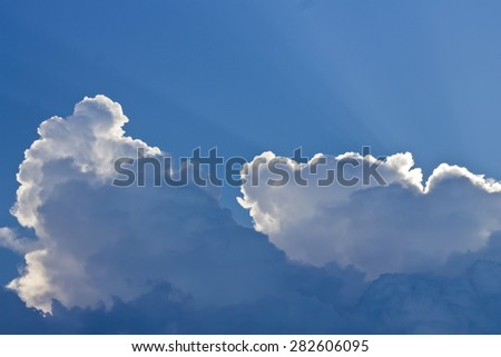 Dramatic sunbeams and storm clouds over Maine - stock photo
