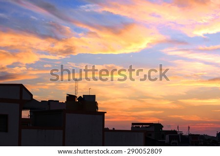 Dramatic sunrise fire in the sky with golden clouds - stock photo