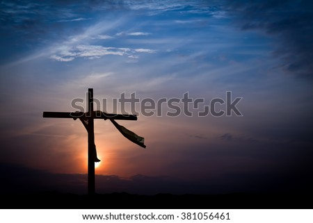 Dramatic Sunrise Lighting and Easter Cross  - stock photo