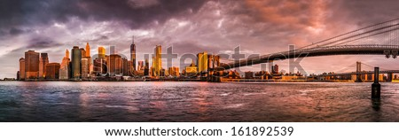 Dramatic sunrise over the Lower Manhattan and the Brooklyn Bridge as viewed from the Brooklyn Bridge Park (52Mpx) - stock photo