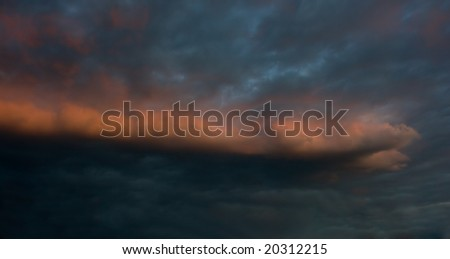 Dramatic sunrise with red cloud in the countryside - stock photo