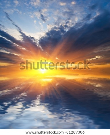 dramatic sunset above a water - stock photo