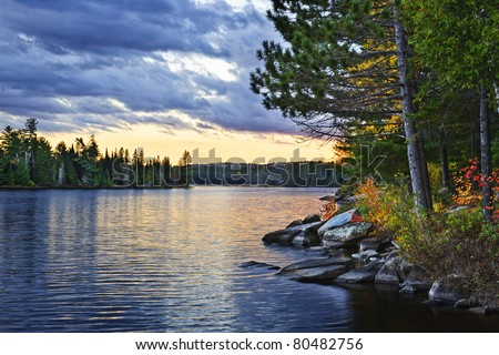 Dramatic sunset and pines at Lake of Two Rivers in Algonquin Park, Ontario, Canada - stock photo