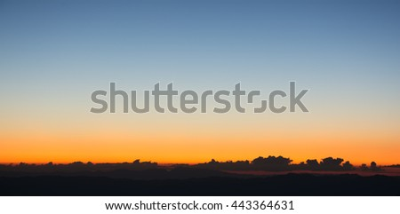 Dramatic sunset and sunrise sky and the sun goes up or down behind cloud. - stock photo