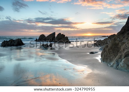 Dramatic sunset at Freathy beach on Whitsand Bay in Cornwall - stock photo
