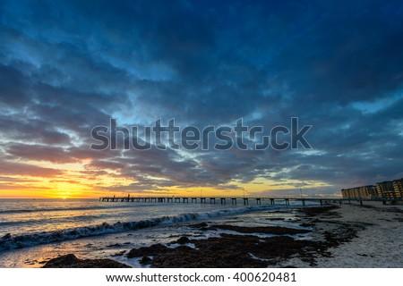 Dramatic sunset at Glenelg Beach, South Australia - stock photo