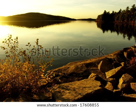 Dramatic sunset at lake. Autumn, October. Algonquin Provincial Park, Ontario, Canada. - stock photo