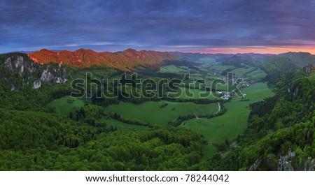 Dramatic sunset in green summer mountain. - stock photo