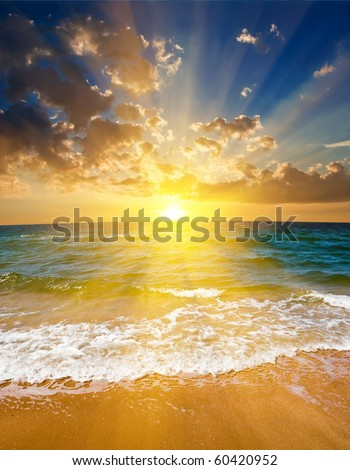 dramatic sunset on a sea coast - stock photo