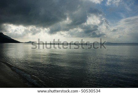 dramatic sunset on the beach in Thailand - stock photo