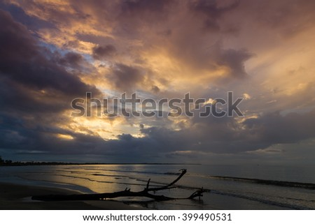 Dramatic sunset on the ocean. Clouds illuminated by sun .Fiji. - stock photo