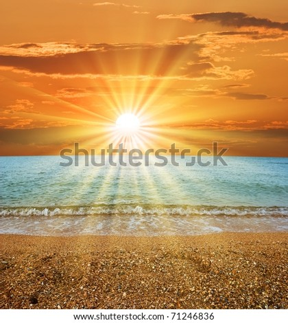 dramatic sunset over a lake - stock photo