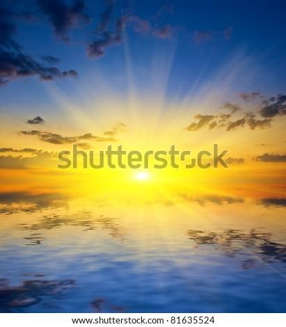 dramatic sunset over a lake - stock photo