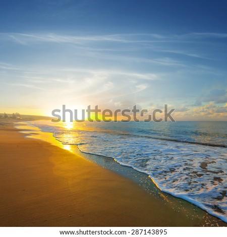dramatic sunset over a sea - stock photo