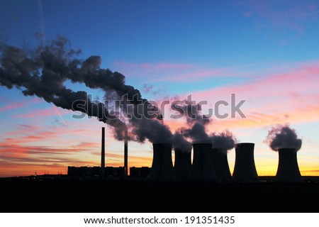 dramatic sunset over coal power plant - stock photo