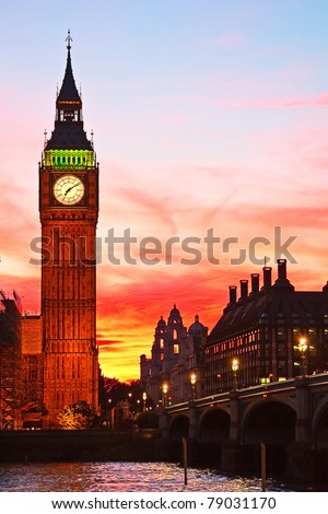 Dramatic sunset over famous Big Ben clock tower in London, UK. - stock photo